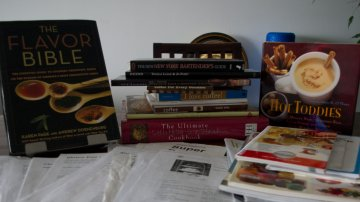 collection of cookbooks and recipes printed from the internet